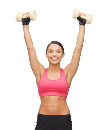 picture of young sporty woman with light dumbbells Stock Photo - 18822382
