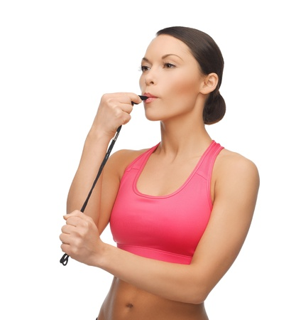 sporty woman with whistle looking at something Stock Photo - 18822397