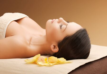 beauty parlor: picture of woman in spa salon lying on the massage desk