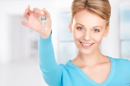 picture of happy woman with keys at home photo