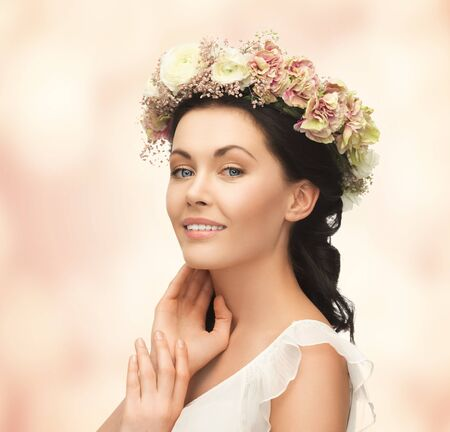 nude bride: picture of young woman wearing wreath of flowers Stock Photo