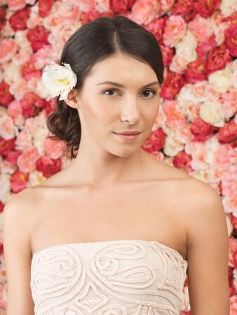 beautiful woman with background full of roses photo
