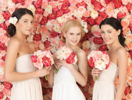 beautiful three women with background full of roses photo