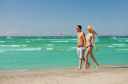 barbados: picture of happy couple walking on the beach