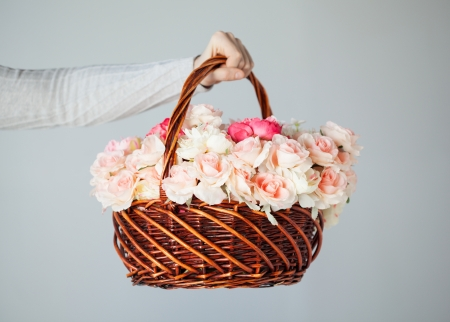 man s: close up of man s hand holding basket full of flowers
