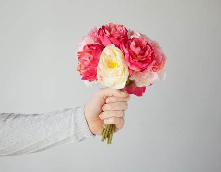 close up of man s hand giving bouquet of flowers Stock Photo - 19001306