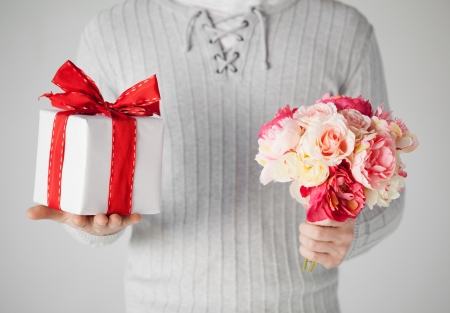 close up of man holding bouquet of flowers and gift box Stock Photo - 19001310