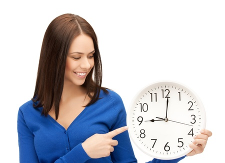 attractive businesswoman pointing her finger at wall clock photo