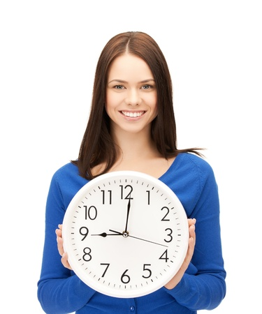 wall clock: picture of attractive businesswoman with wall clock Stock Photo