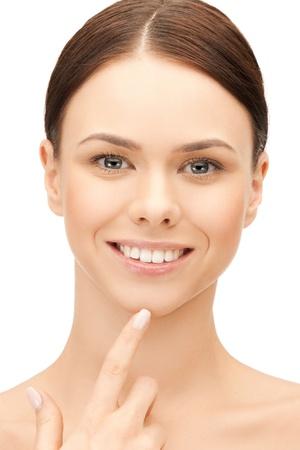 face of beautiful woman touching her chin photo
