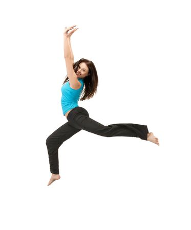 slender woman: picture of beautiful sporty woman jumping in sportswear Stock Photo