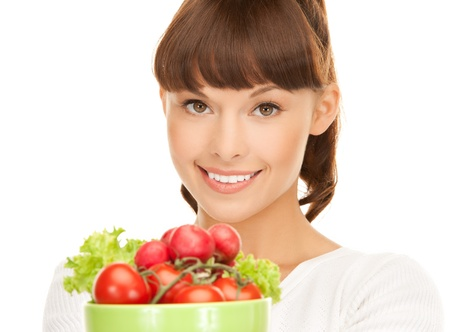 beautiful woman in the kitchen with tomatoes   photo