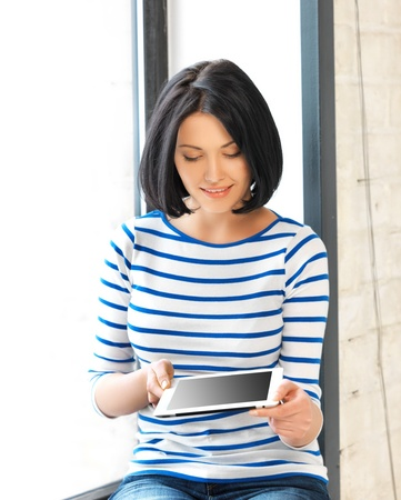 windowsill: picture of student girl with tablet pc