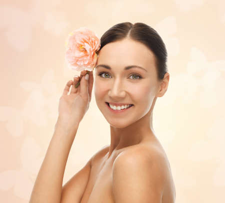 perfect face: bright picture of smiling woman with flower Stock Photo