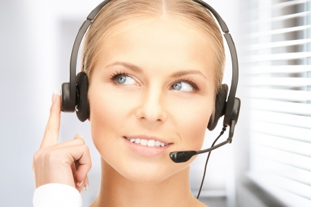 bright picture of friendly female helpline operator Stock Photo - 19097407