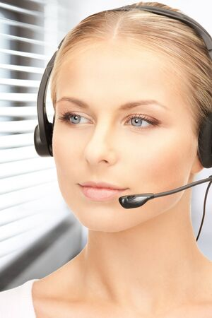 bright picture of friendly female helpline operator Stock Photo - 19097416