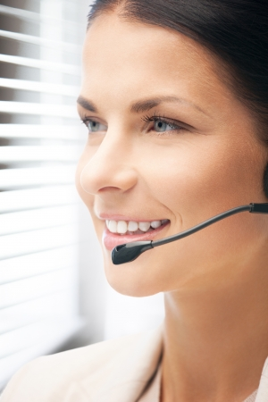 bright picture of friendly female helpline operator Stock Photo - 19097348