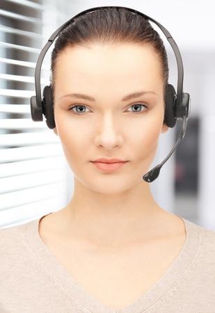 bright picture of friendly female helpline operator Stock Photo - 19097397