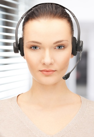 bright picture of friendly female helpline operator Stock Photo - 19097397