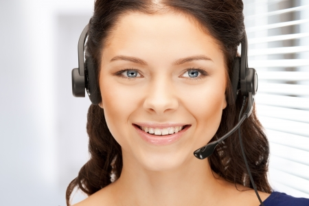 bright picture of friendly female helpline operator Stock Photo - 19097411