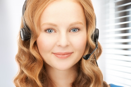 bright picture of friendly female helpline operator Stock Photo - 19097415