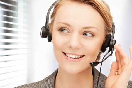 bright picture of friendly female helpline operator Stock Photo - 19097406