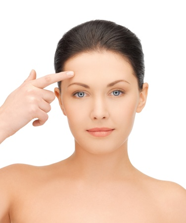 forehead: face of beautiful woman touching her forehead Stock Photo