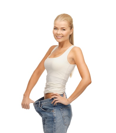 fat burning: picture of sporty woman showing big pants Stock Photo