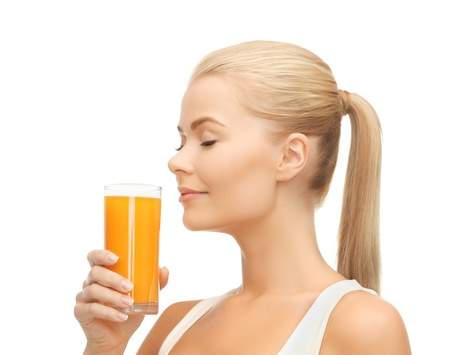 picture of young woman drinking orange juice photo