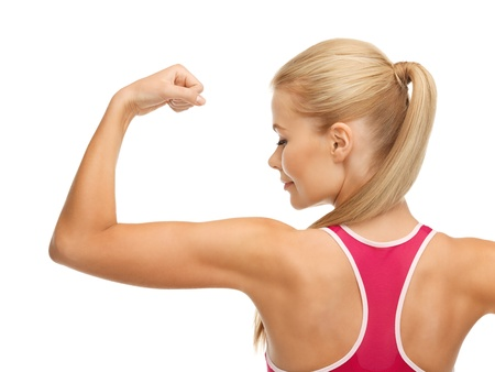 picture of young sporty woman showing her biceps photo