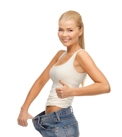 picture of sporty woman showing big pants and thumbs up photo