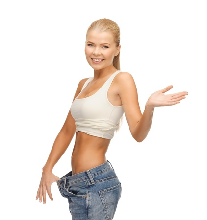 kilo: picture of sporty woman showing big pants Stock Photo