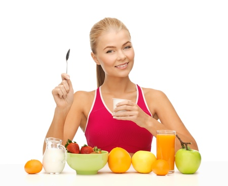 insist: picture of young woman eating healthy breakfast