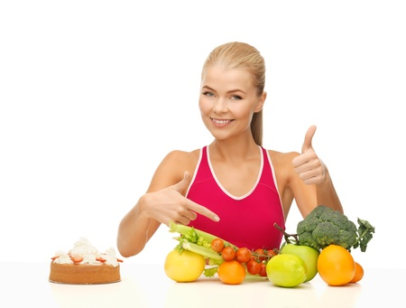 bad diet: woman with fruits and cake pointing at healthy food