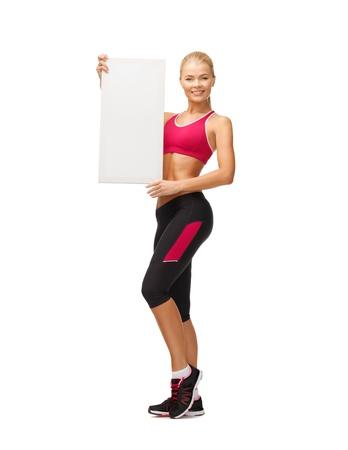 happy smiling sportswoman with white blank board