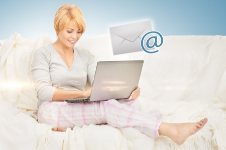 picture of woman with laptop computer sending e-mail photo