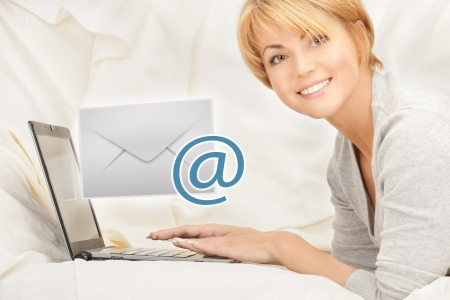 close up of woman with laptop computer sending e-mail photo