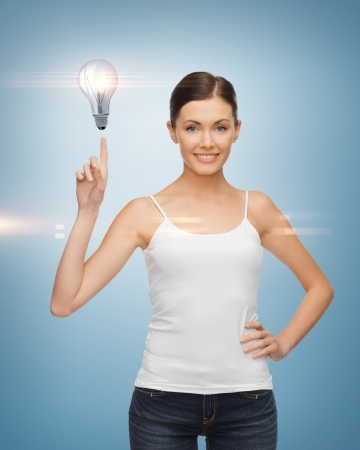 beautiful woman pointing her finger at light bulb photo