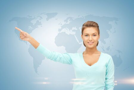 weather report: businesswoman pointing her finger at world map