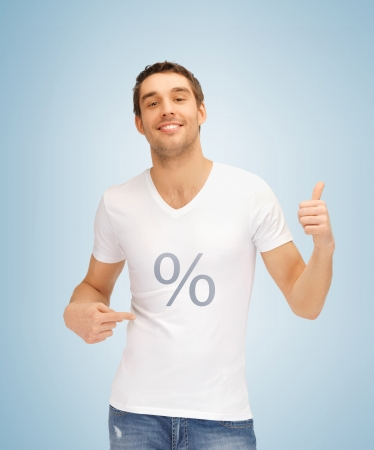 man pointing up: picture of man with percent icon showing thumbs up  Stock Photo
