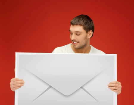 picture of handsome man showing virtual envelope photo