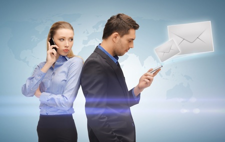 unreachable: picture of man and woman with cell phones Stock Photo
