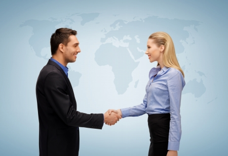 picture of businesswoman and businessman shaking hands photo