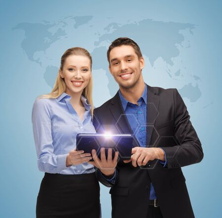 bright picture of man and woman with tablet pc and world map photo