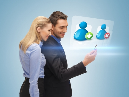 bright picture of man and woman reading sms Stock Photo - 19146369