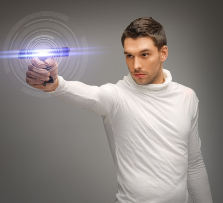 picture of futuristic man with sci fi weapon Stock Photo