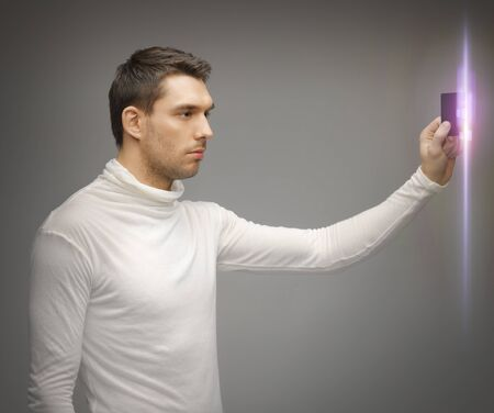 swipe: picture of futuristic man with access card Stock Photo