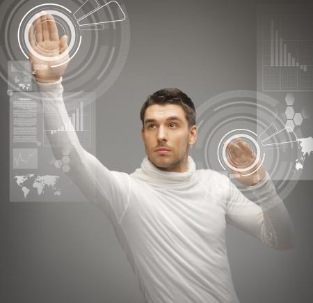 futuristic man: picture of futuristic man working with virtual screens Stock Photo