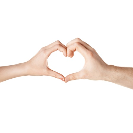 close-up of woman and man hands showing heart shape photo