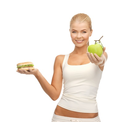 dilemma: picture of sporty woman with apple and hamburger